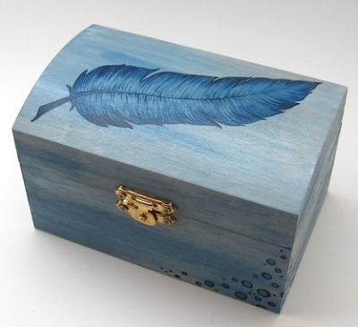 blue box with image of feather