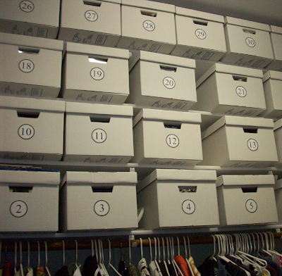 closet with numbered bankers boxes