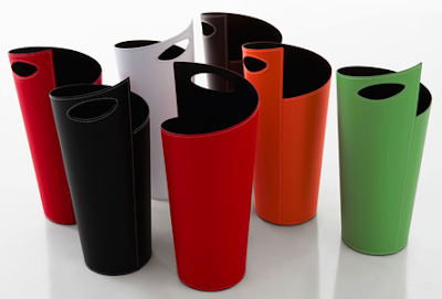 umbrella stands in many colors - white, orange, black, green, red, brown