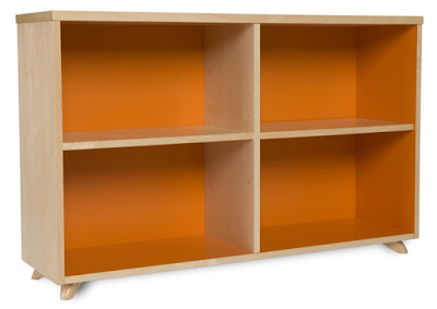 low bookcase with colorful orange backing