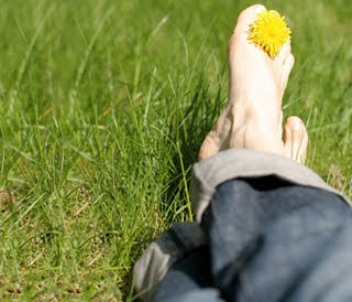 Photo of feet resting on grass