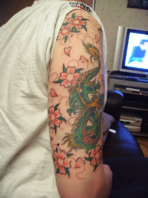 celtic dragon tattoo tattoo sleeve consists of cheery blossom tattoo and