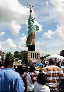 Tennessee replica of Statue of Liberty holding a cross