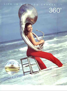 Topless Sousaphone Girl at the Beach selling Perfume