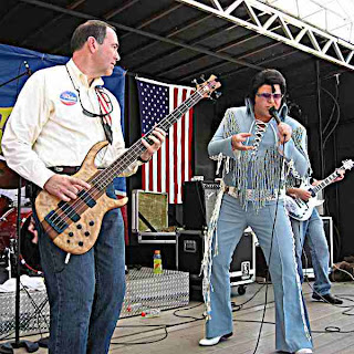 Mike Huckabee plays bass in Iowa with Blue Elvis Impersonator