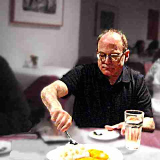 Composer Richard Emmet attacks a plate of Mango Sticky Rice (c) David Ocker