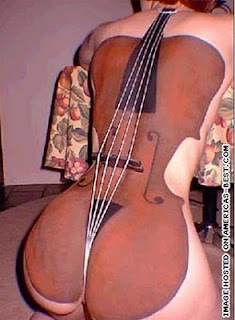 body painting - woman with cello painted on her back
