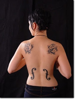 woman with f-hole tattoos