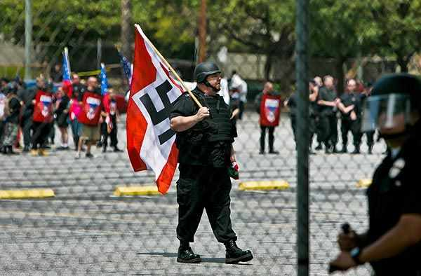 White supremacist waving swastika flag in downtown Los Angeles April 17 2010