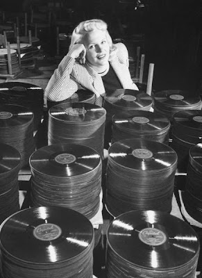 Peggy Lee with stacks of wax