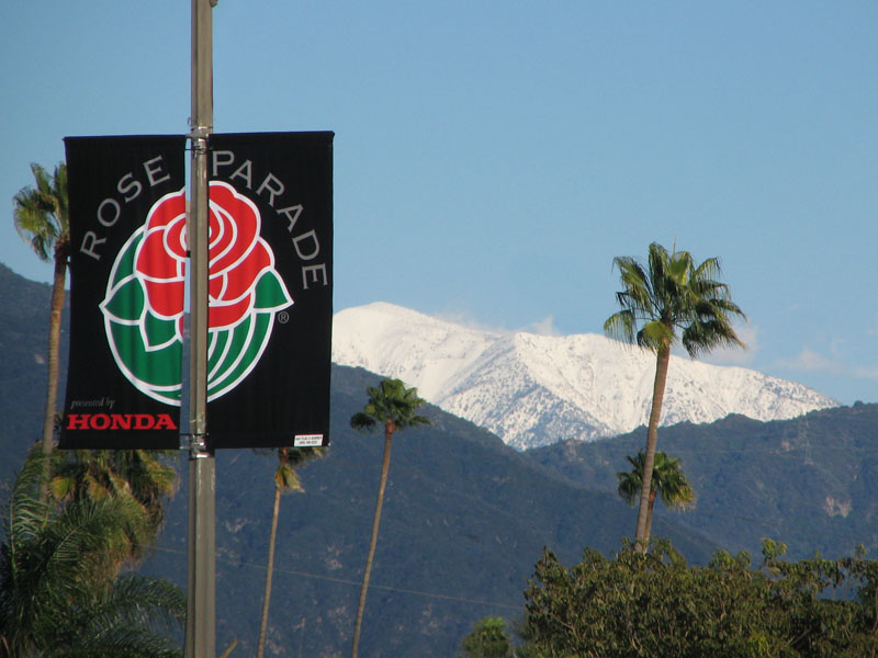 snow capped mountain and Rose Parade banner sponsored by Honda