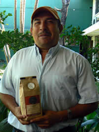 c.o.e. winning coffee farmer, amedeo figueroa, with his coffee from zoka