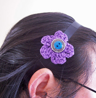 image of crochet flower button and ribbon headband
