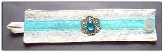 fabric cuff sewn sewing hemtape lace vintage cabochon glass rhinestone blue aqua brass filigree