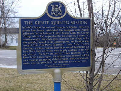 The Kenté (Quinte) Mission: In 1668 Claude Trouvé and François de Fé, Sulpician priests from France, established this mission to serve Iroquois Indians on the north shore of Lake Ontario. Kenté, the Cayuga Village which had reqested the missionaries, became the mission's centre. Buildings were erected at this village, which was probably located in the Consecon area, and livestock was brought from Ville-Marie (Montreal). Under Abbé Trouvé's direction, various resident Sulpicians served the mission but from 1675 their activities were largely confined to the village centre. An early outpost of French influence in the lower Great Lakes region, the mission was abandoned in 1680 as a result of the moving of the Cayugas, heavy maintenance costs, and the growth of Fort Frontenac as a major post.