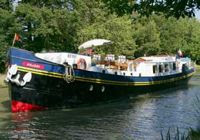 Cruise the French canals aboard French Hotel Barge ANJODI - contact ParadiseConnections.com