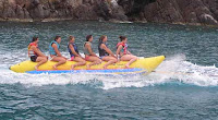 Charter Yacht PROMENADE has lots of fun toys. Ride the Banana! Contact ParadiseConnections.com