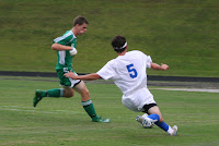 Luke Tompkins hustles for the ball