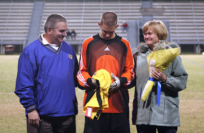 Drew Gay with his parents Angie and Andy Gay