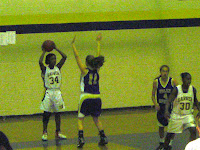 Amber Pleasant inbounds the ball