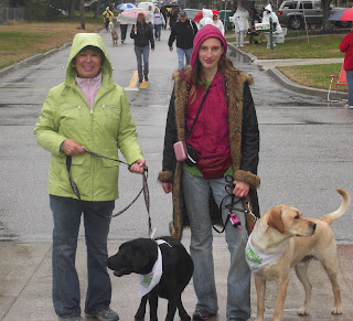 Picture of Toby and I, with Liz and Sparkie. Liz is a PR in our group, Sparkie is a puppy in training, and is a male black lab. We are stopped on the road