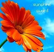 Sunshine award - has a pretty flower in the background