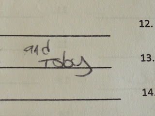 Close up picture of the kick boxing sign in sheet - the words say And Toby