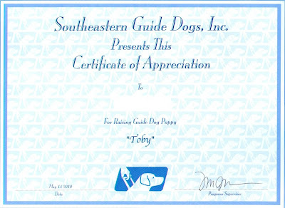 Certificate says: Southeastern Guide Dogs, Inc. Presents This Certificate Of Appreciation. To: (me).  For Raising Guide Dog Puppy: Toby