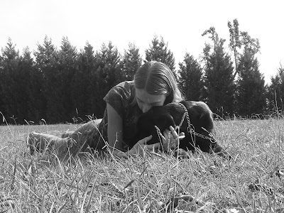 Black/white picture of Rudy & I laying down, my face is resting on top of his head. The picture is taken by my gorilla pod - which is sitting on the ground, so you can see the grass very well