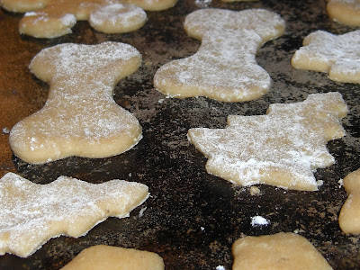 Up close picture of the dog treats (dog bone/Christmas tree shaped) before their cooked