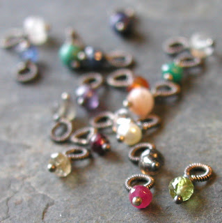 hand crafted wire wrapped faceted gem stones with sterling silver bails