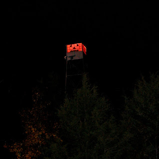 fire tower decorated like a jack-o'-lantern