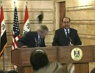 President Bush Ducks Show Thriwn At him.jpg