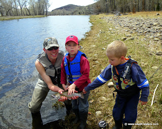 Family fly fishing on the Big Hole River in May
