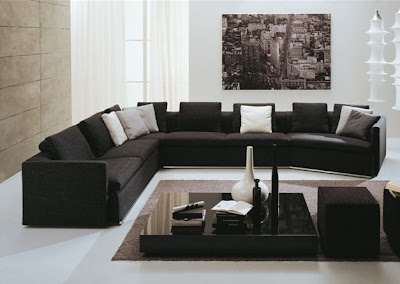 Modern-contemporary-living-room-with-corner-sofa-in-black-leather-low-glass-table