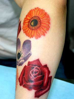 Feminine Flower Tattoo Design on Hand