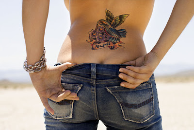 Humming Bird Tattoo Design On Female Lower Back