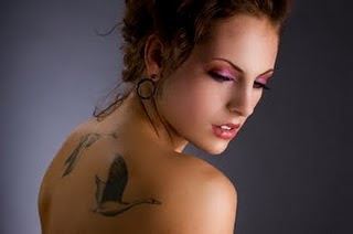 Women with Bird Tattoo