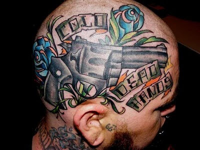 "Gun Tattoo Design on Head. Random Tattoo Quote: ""Every time I get a tattoo,"
