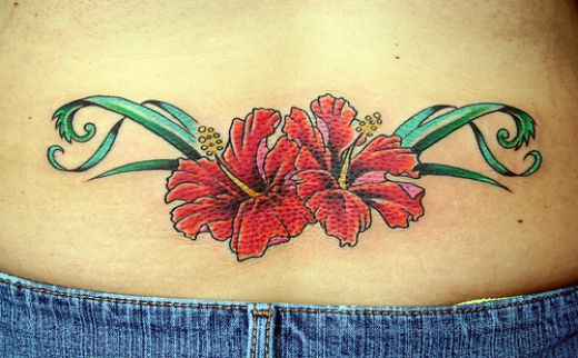 Hawaiian Flower Tattoo on Lower Back of Female