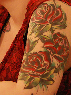 Tattooed women - Rose Flower Tattoo Design