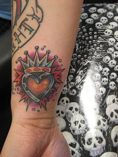 Crown Tattoo with Heart on Wrist