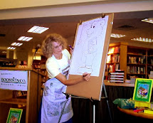Liz Ball drawing a Hidden Picture Puzzle.