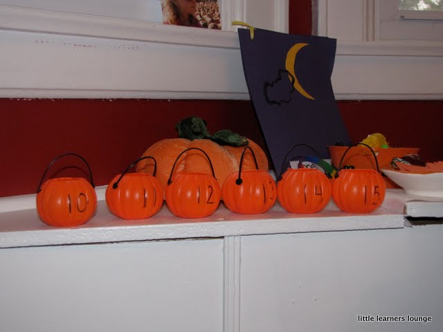 ive added some halloween games to our exploration station the first is a simple counting game using little pumpkin buckets and lima bean ghosts similar