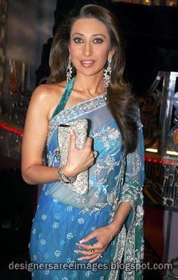Karishma Kapoor in blue designer saree with halter neck blouse design
