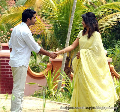 Trisha in plain Yellow Saree from the movie Vinnai Thandi varuvaya