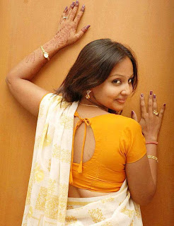 Television Anchor Ishika in white saree and fancy blouse with back design