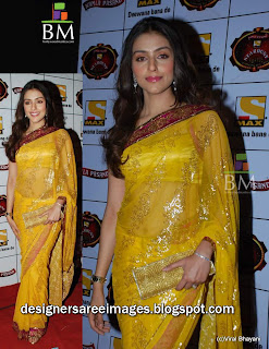 Bollywood Actress Aarti Chabria in Yellow Color Designer Saree