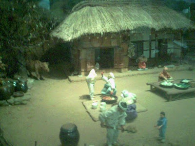 Section of a diorama of village life showing the preparation of Korean sauerkraut