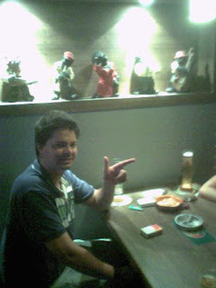 Andy at Garten Bier--note refrigerated wells in table and Negro caricatures